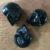 Mini Onyx Crystal Skull Pocket Stone